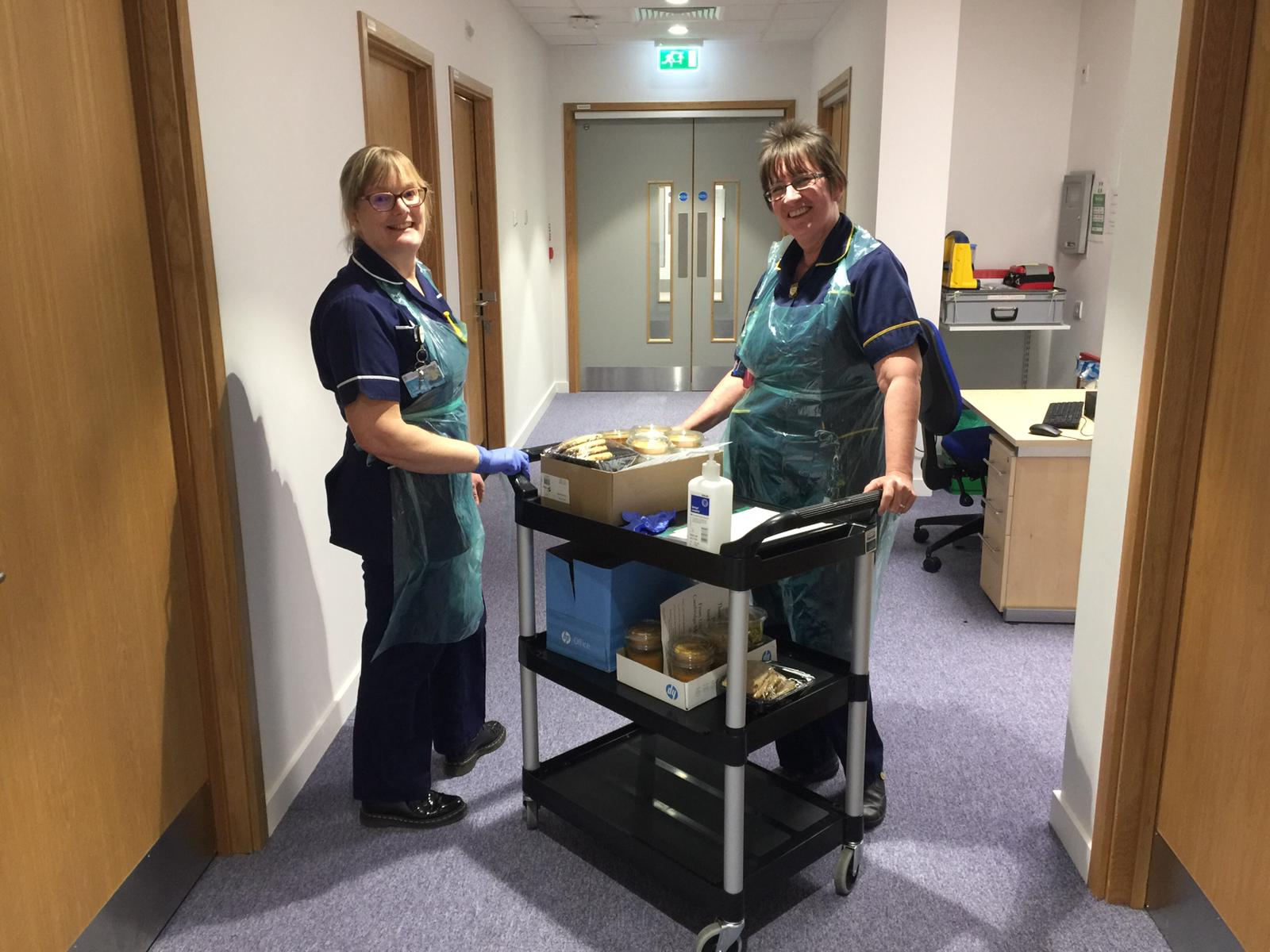 Research nurses from the TRF help to deliver food during the pandemic