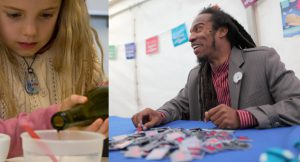Small girl pours liquid; Benjamin Zephaniah at a stand