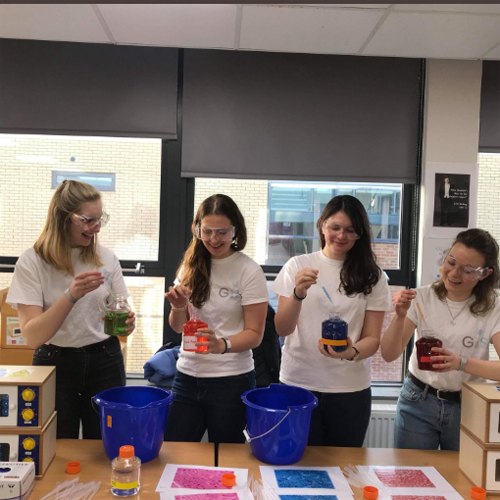 Smiling volunteers at the Girlguiding STEM day