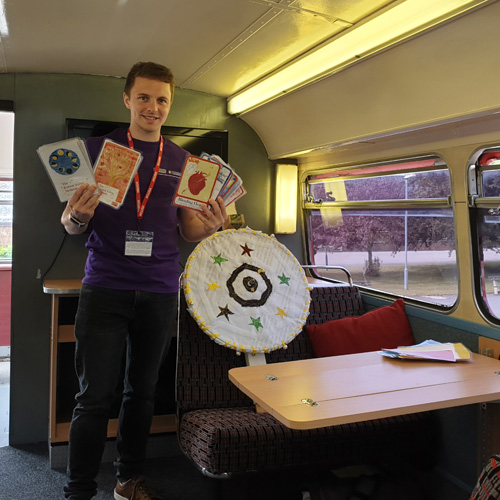 Dr Chris Smith with the wheel of fortune from a public engagement game