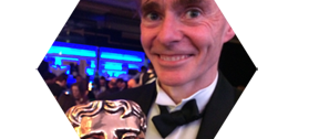 Paul Fletcher holding the BAFTA award